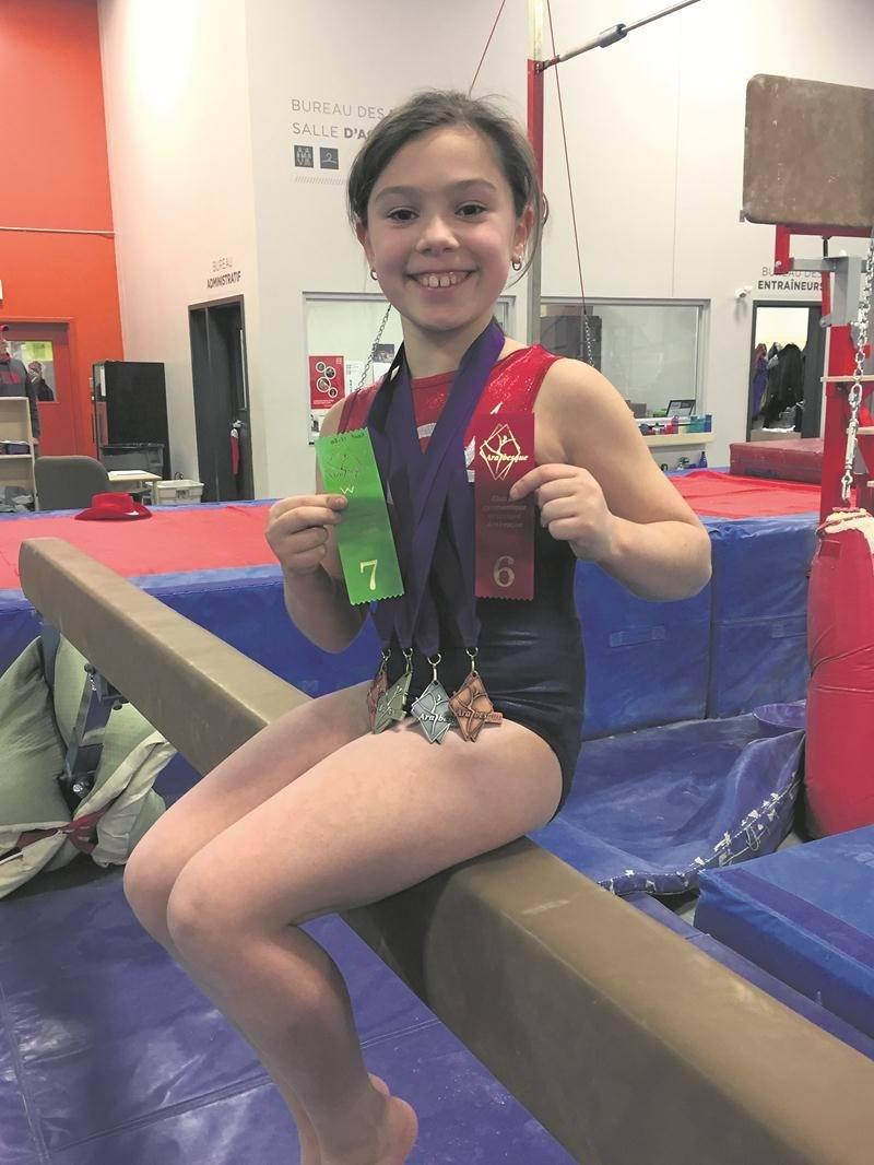 Mia Chouinard a livré de belles performances au sol, aux barres et au trampoline pour se classer au 2e rang de sa catégorie.  Photo Courtoisie