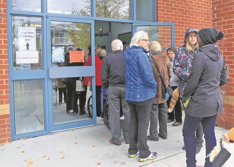 Pour éviter que se forment de longues files d'électeurs comme en 2013, la présidente d'élection a décidé d'ajouter des lieux de votation pour le vote par anticipation du 29 octobre.   Photothèque | Le Courrier ©