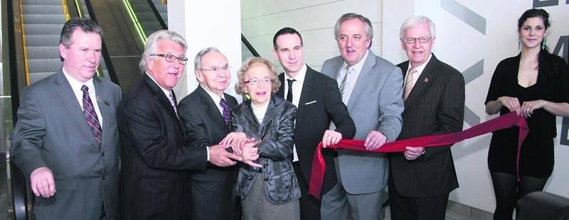 Germain Larivière et ses proches lors de l'inauguration du magasin de Brossard en 2012. Photothèque | Le Courrier ©