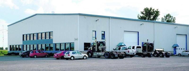 L'entreprise K&C Diesel loue une bâtisse industrielle dans le secteur Saint-Thomas-d'Aquin où elle n'est pas autorisée à opérer. Photo François Larivière | Le Courrier ©