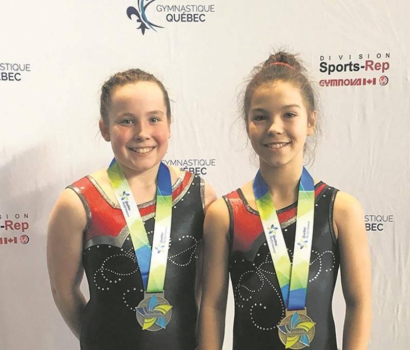 Océane Ferland (à droite) et Charlotte Simoneau (à gauche) ont raflé les deux premières places de la classe provinciale 2 à l'épreuve de tumbling. Photo Courtoisie