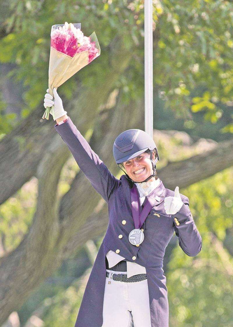 Béatrice Boucher, tout sourire au championnat nord-américain jeunesse de sports équestres.  Photo Cealy Tetley