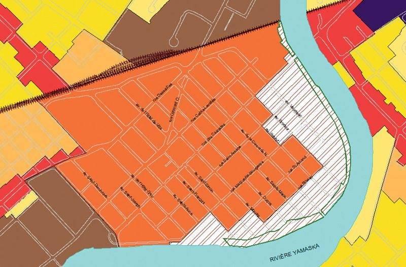 La nouvelle affectation « centre-ville riveraine » est représentée en blanc sur le plan. Plusieurs usages, dont « habitation forte densité », y seraient dorénavant permis.