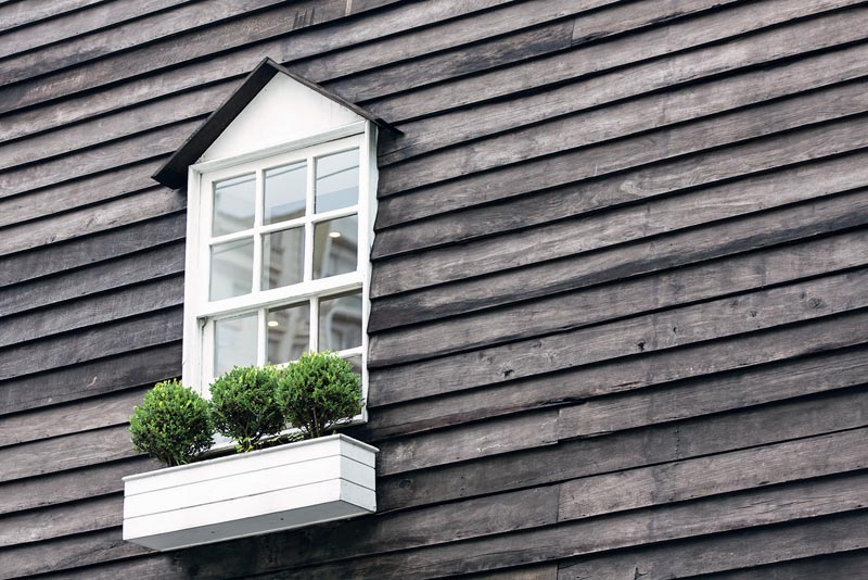 White window on old wooden plank wall